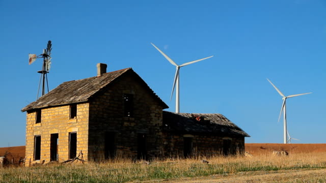 Stone House Old New Wind Turbines Blowing