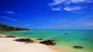 Stone on the clear tropical beach