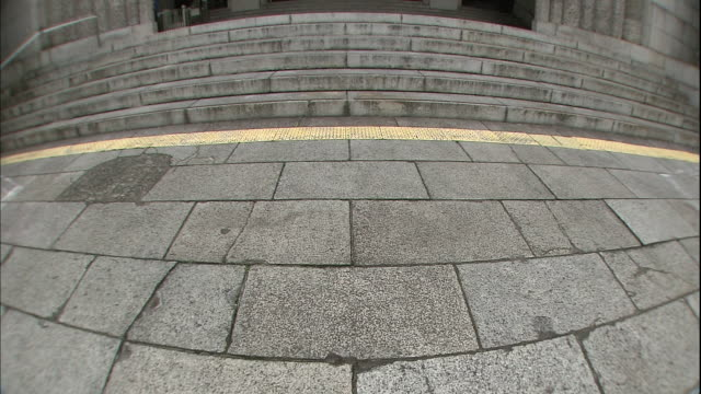 Stone pavement leads to the main entrance of the Osaka Prefectural Government Office
