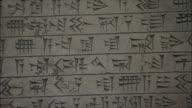 ECU PAN Stone plaque covered with Cuneiform script in National Museum of Iran, Tehran, Iran