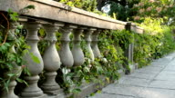 Stone railing of a terrace of ionic style.