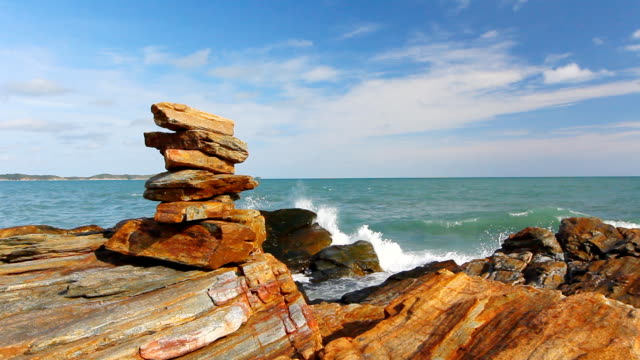 Stone stack stable and wave splash on background at Khao Laem Ya