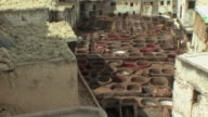 WS HA Stone vessels in leather tannery, Fez, Morocco