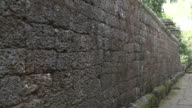 A stone wall surrounds the Bayon temple in Angkor, Cambodia.
