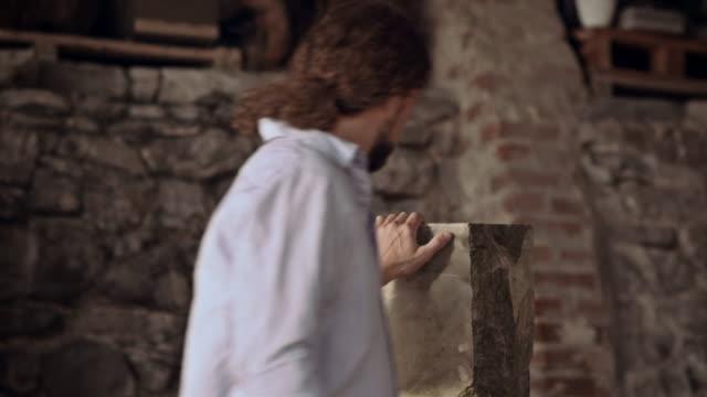 Stonemason inspecting stone