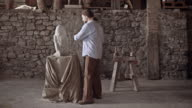 Stonemason starts carving stone with hammer and chisel