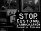 MS 'Stop Customs' sign on border road between northern Ireland Eire customs office checking women's baggage MS Custom agent