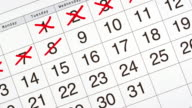 Stop motion animation of a calendar month with days crossed off.