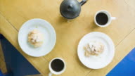 Stop motion animation of coffee being drunk and breakfast being eaten
