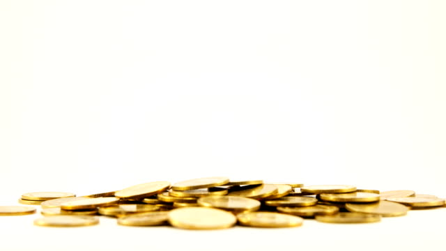 Stop-motion-Goldene Münze auf Stapel.