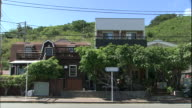 Storage sheds line a residential street on Chichi-Jima Island in Japan.