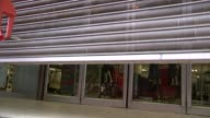 BHS store chain goes into administration / Sir Philip Green potential contribution ENGLAND EXT Metal shutters descending on BHS store