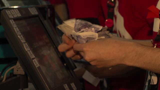 Store transactions at UK Launch Of Nintendo WiiU Console at HMV Oxford Street on November 29 2012 in London England