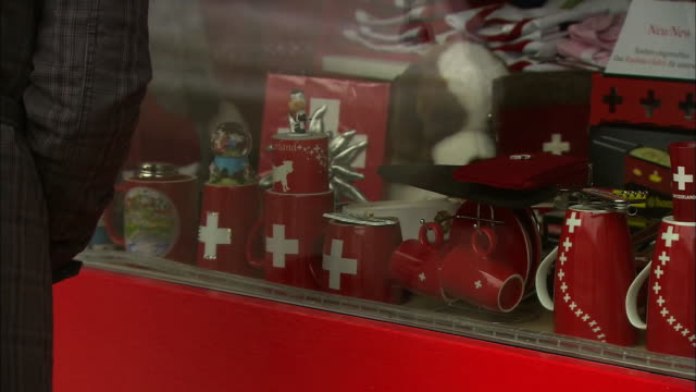 A storefront displays Swiss souvenirs.