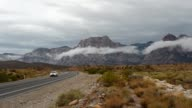 Storm clouds appear at the Red Rock Canyon National Conservation Area on August 26 2013 near Las Vegas Nevada Moisture from Tropical Depression Ivo...