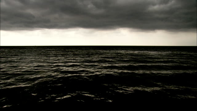 Storm clouds hang over the water near New Orleans, Louisiana. Available in HD.