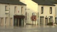 Appleby flooding ENGLAND Cumbria Appleby Flood water along street / Flood water over wall / Flooding through trees / Flooding around houses / Flood...