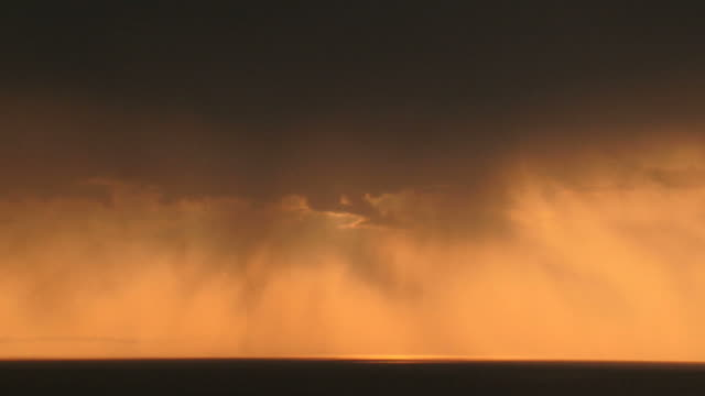 storm front with rain over the sea (time lapse)