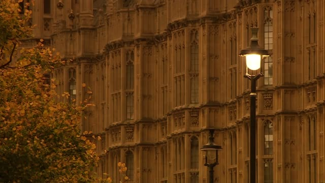 Houses of Parliament and 'orange' sky ground shot ENGLAND London Westminster EXT GVs Houses of Parliament in midafternoon with 'orange' sky /...