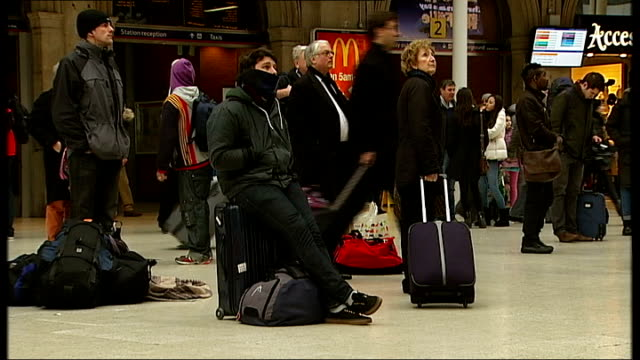 Travel disruption at Waterloo Station ENGLAND London London Waterloo Station INT General views of people with luggage waiting on railway station...