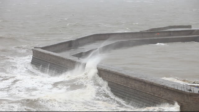 Storm waves during severe weather at Whitehaven, Cumbria, UK.
