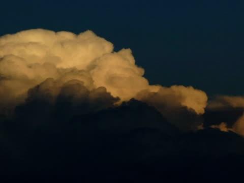 T/L stormy cloud filling frame, Kalahari, South Africa