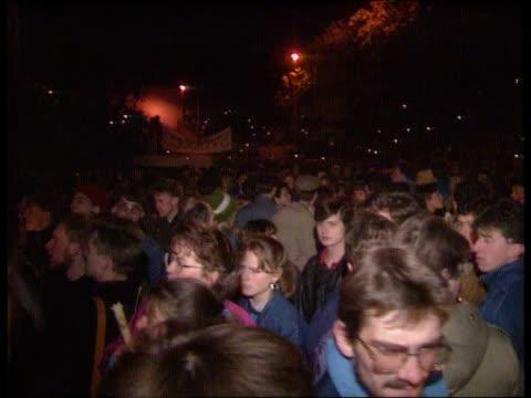 Story 1 ITN LIB EXT/NIGHT/Dec 89 CZECHOSLOVAKIA Prague SEQ Mass prodemocracy demos/ candles lit/ demos holding long banner walk towards riot police...