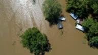 Rechtstreeks naar beneden boven enorme overstromingen met schuur, huizen en gebouwen onder water in Columbus, Texas kleine stad Gulf Coast schade zone van Orkaan Harvey Path of Destruction.