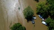 Recht naar beneden de weergave van de drone boven overstroomde huizen bijna volledig onder water Columubus, Texas kleine stad Gulf Coast schade zone van Orkaan Harvey Path of Destruction.