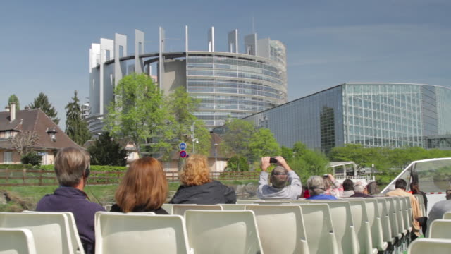 HD Strasbourg. European Parliament seen from the point of view of a tourist in a boat tour crossing the Ill river.