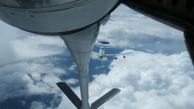 Stratotanker attached to the 350th Air Refueling Squadron refueling fighters during RED FLAGAlaska 172 June 16 at Eielson Air Force Base Alaska RED...