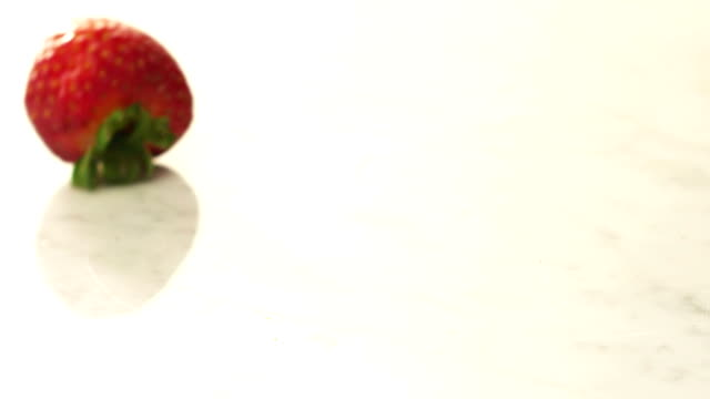 Strawberries rolling