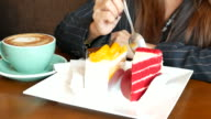 Strawberry cake cutting  for relaxing at coffee cafe and cake