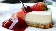 Strawberry cheese cake with serving and cutting cake