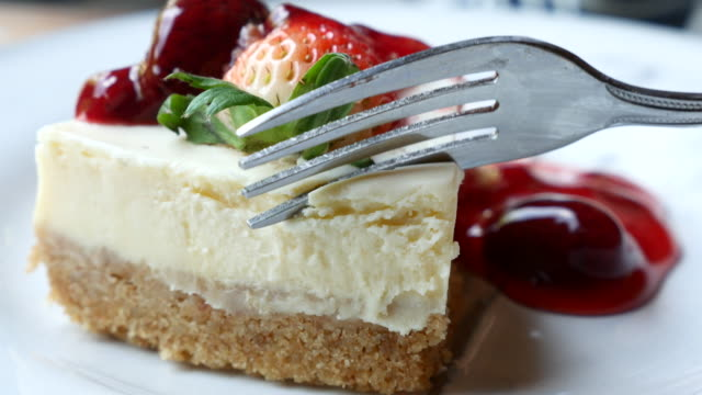 Strawberry cream cake serving and cutting