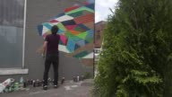 Street artist decorates office wall as camera zooms forward timelapse in Toronto Ontario Canada on June 24 2017