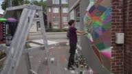 Street artist decorates office wall timelapse in Toronto Ontario Canada on June 24 2017