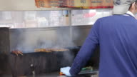 Street barbecue grill in Flushing, Queens, New York