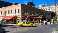 T/L Street corner bust with outdoor cafeé, pedestrians, and traffic / New York City, New York, United States