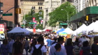 Street Fair was opened on Broadway between Union Square and Waverly Place Manhattan New York on Aug. 13 2017. People walk down among the many shopping booths and food venders along the both side of Broadway.