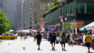 Street Fair was opened on Park Avenue between 45th street and 57th street Midtown Manhattan New York on Aug. 27 2017. People walk down among the many shopping booths and food venders along the Park Avenue. City traffic crosses among the crowded Avenue.