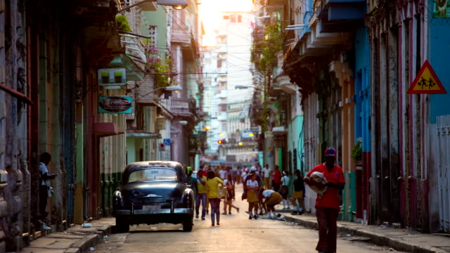 Street in Havana, Cuba with vintage American Car
