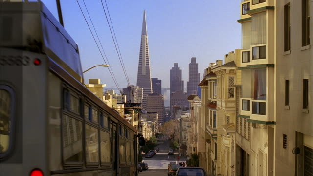 MS, Street in residential neighborhood wit Transamerica Pyramid in background, San Francisco, California, USA,