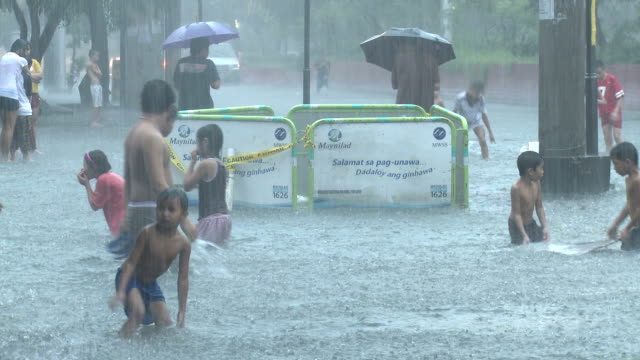 Street Kids Play In Flood Waters Manila Philippines