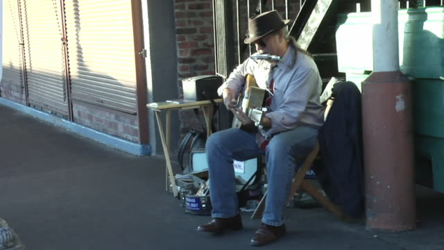 WS, Street musician playing blues guitar with slide and harmonica, Seattle, Washington, USA