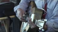 WS, ZO, CU, Street musician playing blues guitar with slide and harmonica, Seattle, Washington, USA, ZI