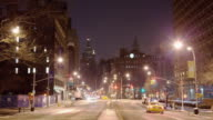 T/L, WS, Street scene, 4th St. and Bowery, Empire State Building and Cooper Union in background, night, New York City, New York, USA