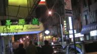 MS, Street scene in Chinatown at night, New York City, New York, USA