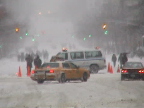 WS, Street scene in snowstorm, New York City, New York, USA