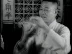 CHINA Street scene w/ rickshaws RESTAURANT Male handed hot hand towel wiping face elder male drinking tea fanning self EXT Large modern building...